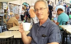 Savoring and listening with Bob at a cafe in Siena, Italy